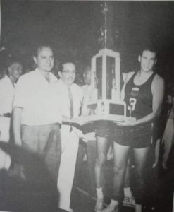 Team skipper Carlos Loyzaga, with coach Arturo Rius and Yco owner Don Manolo Elizalde beside him, holds the championship hardware after the Philippines topped the inaugural ABC tournament in Manila in 1960 with a 9-0 record and an average winning margin of 29.4 points a game. [Henry Liao photo]