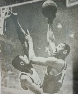 Wilt Chamberlain tries a short hook over the outstretched arm of arch nemesis Bill Russell during their fierce NBA rivalry in the 1950s and 1960s.