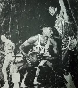 A stonewall defense by the name of Bill Russell keeps Philadelphia 76ers' Wilt Chamberlain at bay.