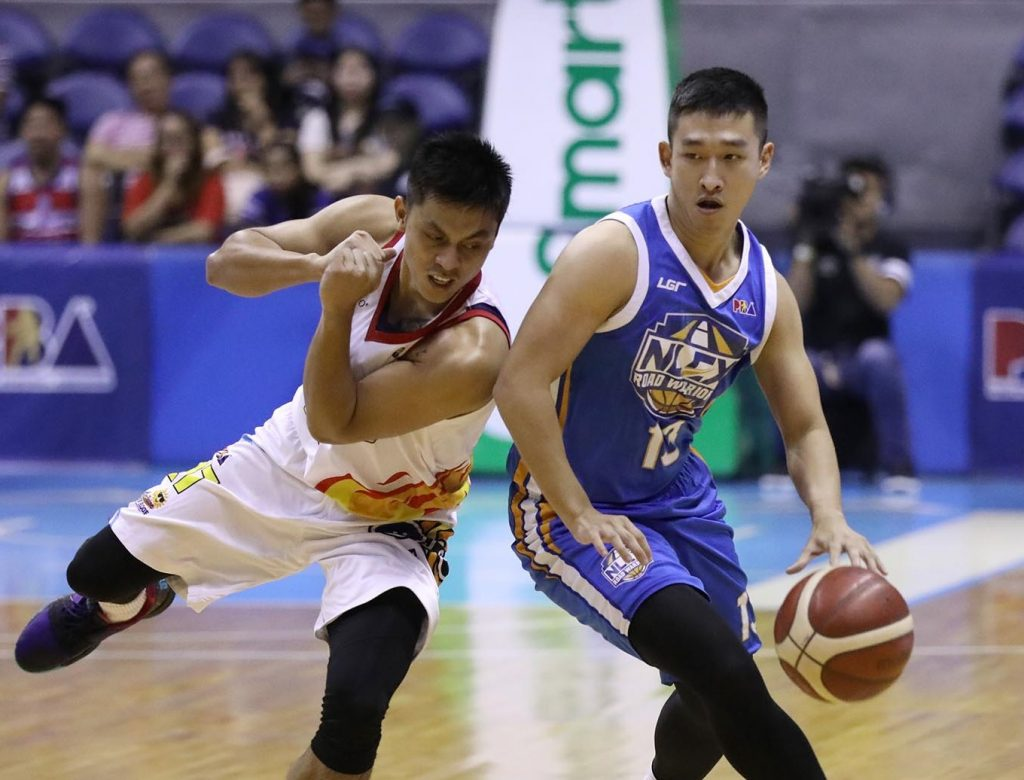 Kyles Lao of the NLEX Road Warriors drives past rey Mabatac of the Rain or Shine Elasto Painters [photo: PBA Images]