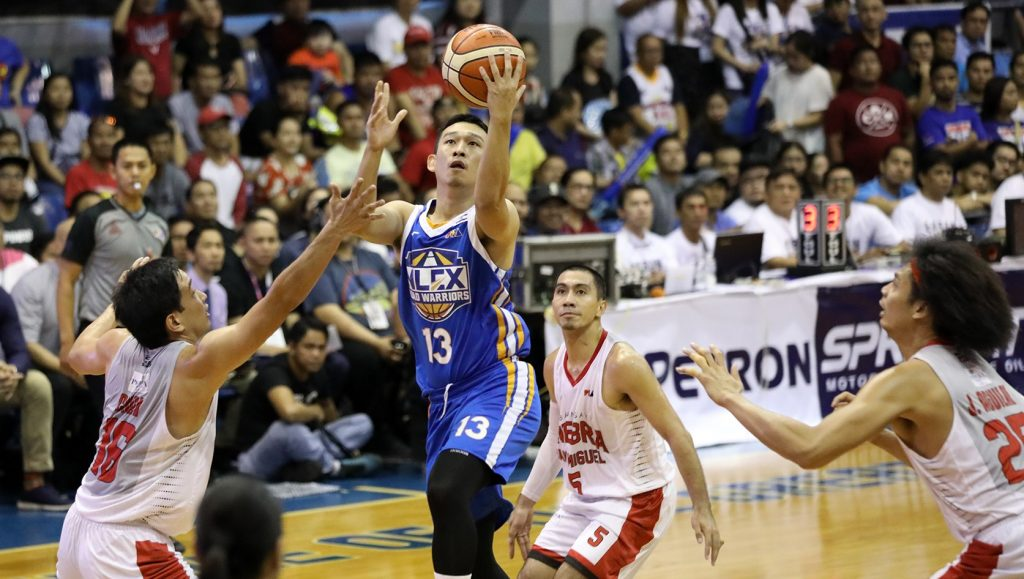 Kyles Lao of the NLEX Road Warriors lays it in against Ginebra defenders, Jeff Chan and Japeth Aguilar. [photo: PBA Images]