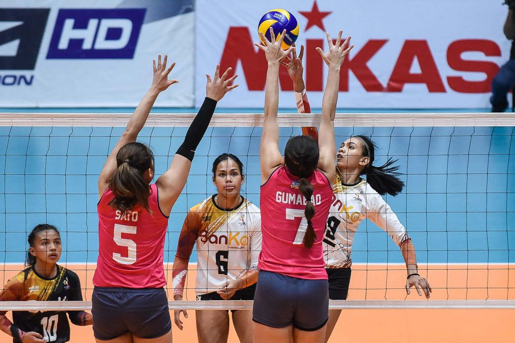 BanKo-Perlas' Nicole Tiamzon challenges Creamline's RIsa Sato and Michele Gumabao during their PVL Open match.
