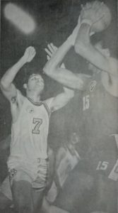 Jaworski, here donning the Meralco colors, defends against Yco import Charles Walker in MICAA action. Jaworski, a former Painter, led the Reddy Kilowatts to the MICAA Open crown in 1971.