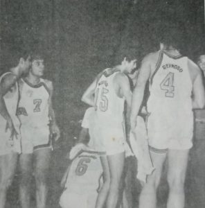 Jaworski and his Meralco teammates huddle around their head coach Lauro Mumar during MICAA action.