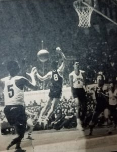 Narciso Bernardo (No. 5) receives a nifty assist from Jimmy Mariano (No. 6) in the PH-South Korea title duel.
