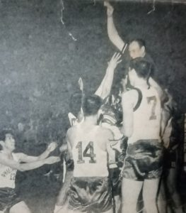 National team coach Caloy Loyzaga gets the traditional victory ride from his boys after piloting the Filipinos to the 1967 ABC crown.