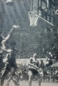 Robert Jaworski (No. 15, far left) hoists a shot off South Korea's Kim Il Young as teammate Alberto (Big Boy) Reynoso (No. 4) waits for a possible rebound in the titular match of the 1967 ABC tournament.
