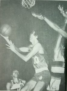 """El Presidente"" Ramon Fernandez scoops for an uncontested layup against Crispa in 1975 PBA action. Toyota picked up two of the three conference championships at stake in the pro league's inaugural season."