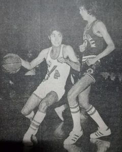 Heady Yco playmaker Mike Bilbao navigates around Manila Bank's Virgilio (Gil) Cortez in 1975 MICAA All-Filipino finals action.