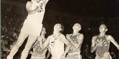 The legendary Julian Macoy scores on an easy twinner against Meralco in a MICAA game. He played for Yutivo from 1961 to 1970.