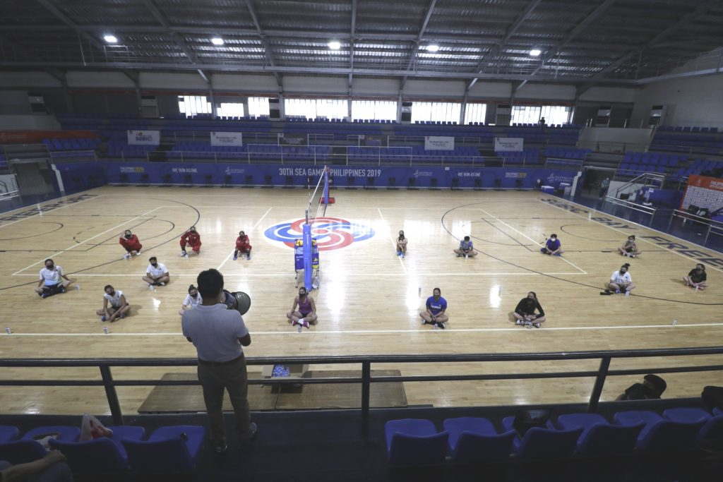 """Philippine National Volleyball Federation president Ramon """"Tats"""" Suzara gives a message to the 16 aspirants—a mix of veterans and promising collegiate players—answering the whistle in the PNVF tryouts for the national women's volleyball team at the Subic Gym on Wednesday."""