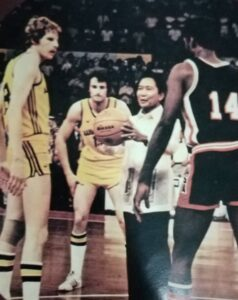 President Marcos tosses the ceremonial ball to usher in the 1978 World Basketball Championship at the Araneta Coliseum. It was less than half-filled as only around 10,000 spectators showed up at the 22, 000-seat Big Dome.